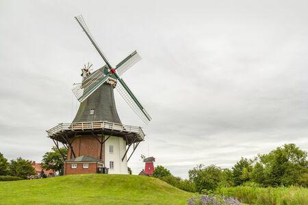 the twin windmills in Greetsiel, a idyllic village located in East Frisia, Northern Germany