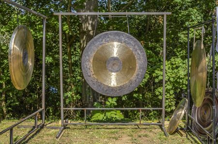 some big chinese chau gongs in sunny green ambiance