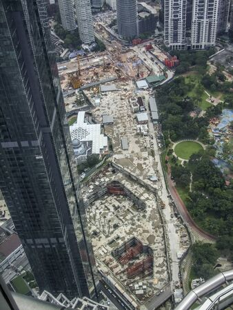 high angle aerial view including a big construction site around Kuala Lumpur City Centre in Malaysia