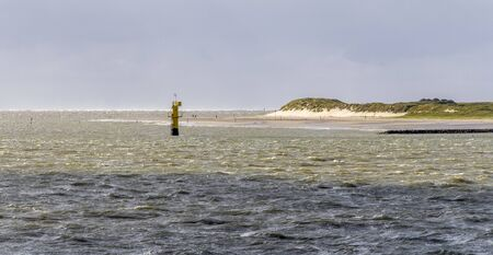 coastal impression seen at Spiekeroog, one of the East Frisian Islands at the North Sea coast of Germany Фото со стока