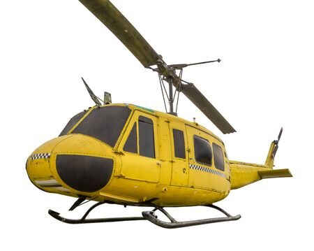historic yellow helicopter isolated in white back