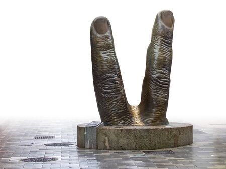 victory sign sculpture seen in Epinal, the capital city of the Vosges departmend in France 스톡 콘텐츠