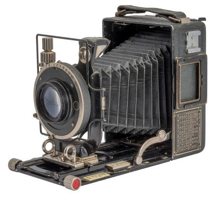 historic folding camera isolated in white back