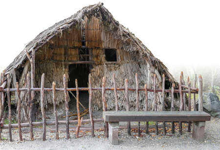 Traditional Maori house seen in New Zealand, partly isolated in white back