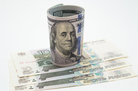 roubles: One hundred dollar bills and russian roubles
