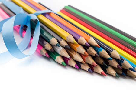 coloured pencils: set of coloured pencils wrapped in a blue ribbon Stock Photo