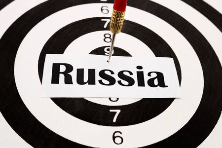 editorial: Word Russia pinned on darts Stock Photo