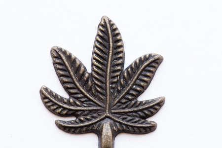 ganja: metal symbol marijuana Stock Photo