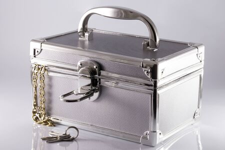 gold chain: Silvery suitcase-box with keys and gold chain