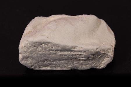 kaolin: kaolin stone on black background
