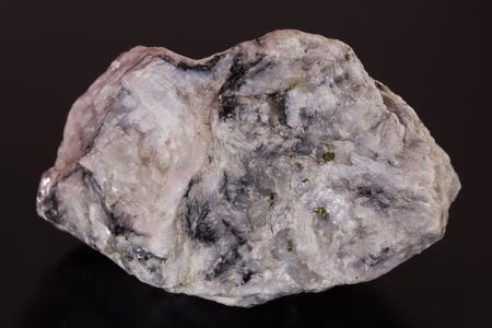 kaolin: magnesite stone on black background Stock Photo