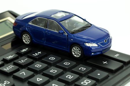 car and calculator Stock Photo
