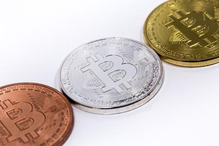 net trade: three bitcoins on white backround