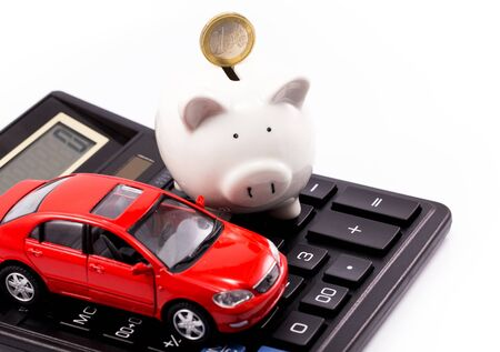 piggy bank and euro with car