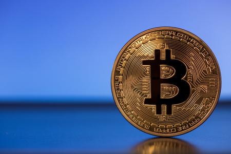 e cash: bitcoin metall symbol on blue background