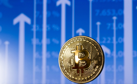 golden bitcoin on chart with cursor Stock Photo