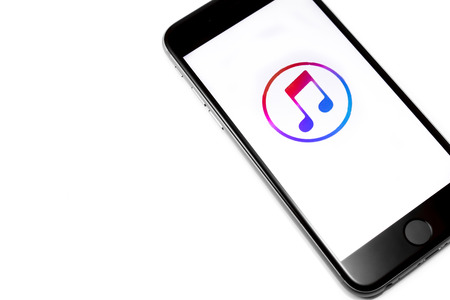 Black Apple iPhone 6s with new iTunes logo. Apple Music is the new iTunes-based music streaming service that arrived on iPhone. Chelyabinsk, Russia - March 03, 2016 Stock Photo