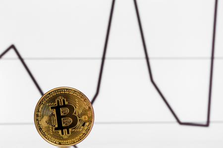 upturn: one golden bitcoin on chart