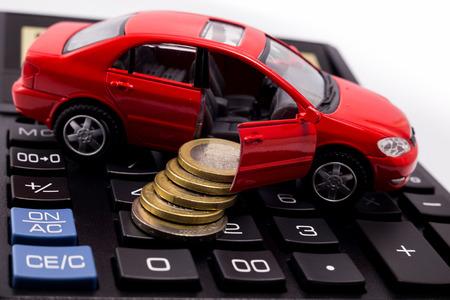 car model, coins on a calculator