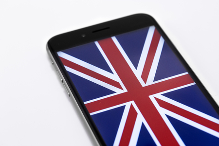 yes or no to euro: Brand black Phones and British flag on the screen. Stock Photo