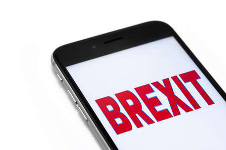 yes or no to euro: Brand black Phone and word Brexit on the screen. Stock Photo