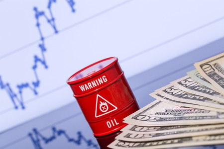 prognosis: barrel of oil, dollars on blue chart Stock Photo
