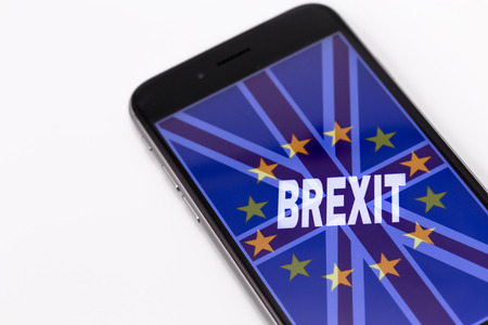 yes or no to euro: Brand black Phone and British flag and European Union on the screen.