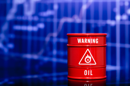barrel of oil on blue chart Stock Photo