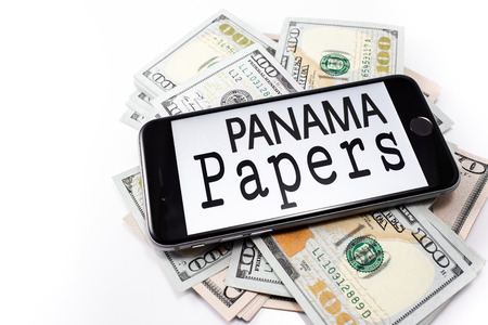 bandera panama: Brand black Apple iPhone 6s with text Panama papers on the screen, with money, dollar. Chelyabinsk, Russia - April 14, 2016