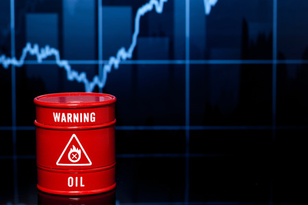 brent crude: red barrel of oil on blue chart Stock Photo