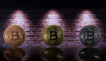 three bitcoins under the light