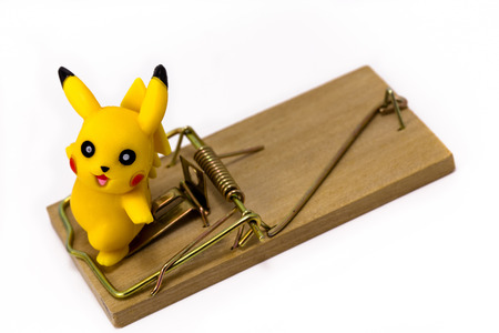 Pickachu toy character from Pokemon anime, with mousetrap. Ekaterinburg, Russia - August 20, 2016