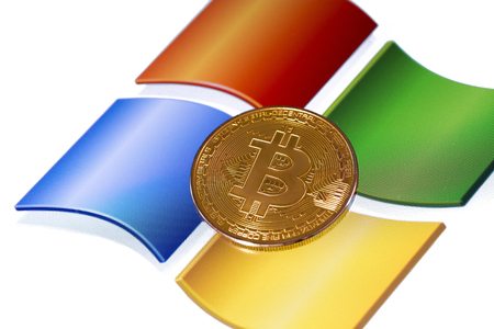 incursion: bitcoin and windows background. Windows is a operating systems developed, marketed, and sold by Microsoft. Ufa, Russia - May 17, 2017