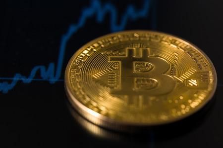 bitcoin with chart Фото со стока