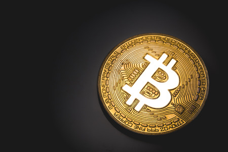 golden bitcoin logo glows in lights Stock Photo