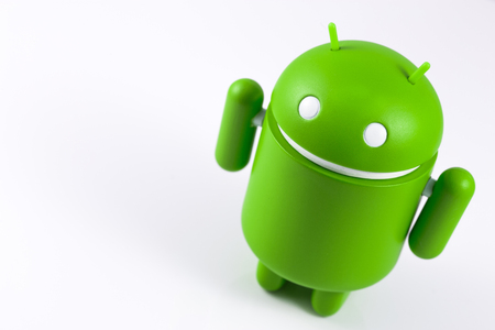 Android symbol figure on the white background.  Android is the operating system for smart phones, tablet computers, e-books, game consoles,  and other devices. Ekaterinburg, Russia - October 15, 2017 Editorial