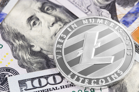 litecoin and one hundred dollars banknote Stock Photo