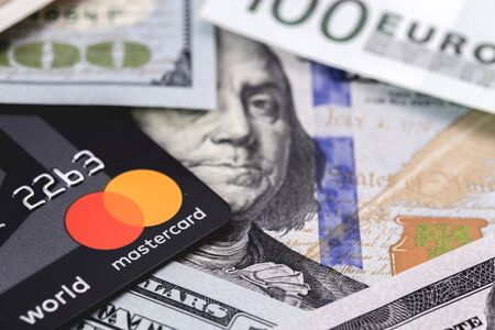 Master Card and money. MasterCard Worldwide is an American multinational financial services corporation. Moscow, Russia - December 8, 2018 Editorial
