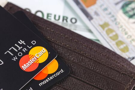 Master Card in the leather brown wallet, close up of credit cards. MasterCard Worldwide is an American multinational financial services corporation. Moscow, Russia - December 8, 2018 Editorial