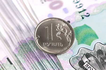Closeup view of one ruble and thousand russian banknotes. Фото со стока