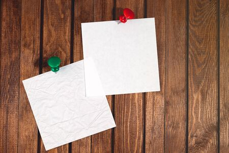 two white empty paper on wooden desk background