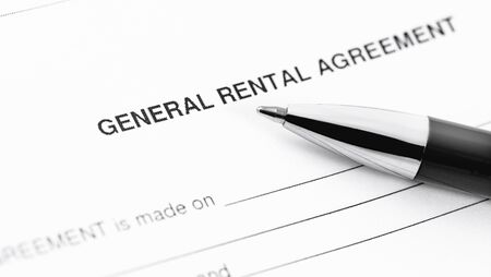 general rental agreement form application with black pen closeup