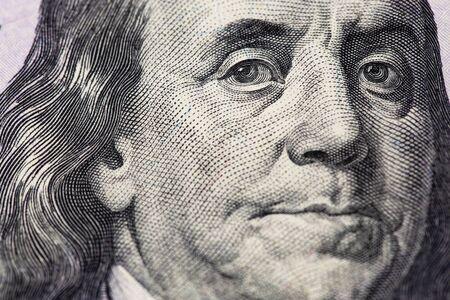 Benjamin Franklin portrait. Hundred dollars banknote closeup macro