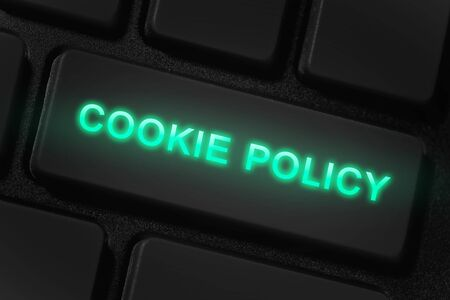 keyboard and button with text Cookie policy, closeup macro