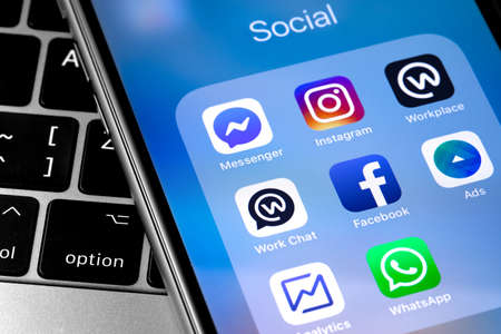 closeup smartphone with icons app (Facebook services, Instagram, WhatsApp). Social media. Facebook is largest and most popular social networking site in the world. Moscow, Russia - April 27, 2019