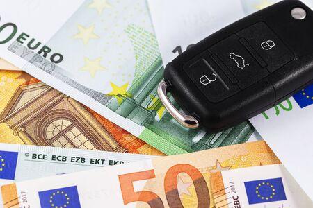closeup car key on euro banknotes