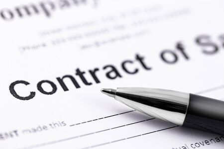 black pen and contract papers. Legal contract signing.