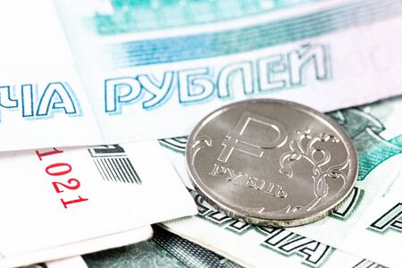 one russian ruble metal coin and 1000 thousand rubles banknotes closeup, macro