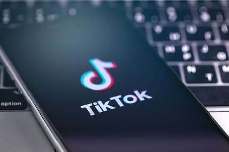 TikTok symbol on the display smartphone closeup. TikTok is app to create and share videos. Moscow, Russia - May 22, 2019