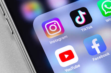 showing popular social media icons of Instagram, TikTok, YouTube, Facebook apps on the screen iPhone. Moscow, Russia - March 24, 2019